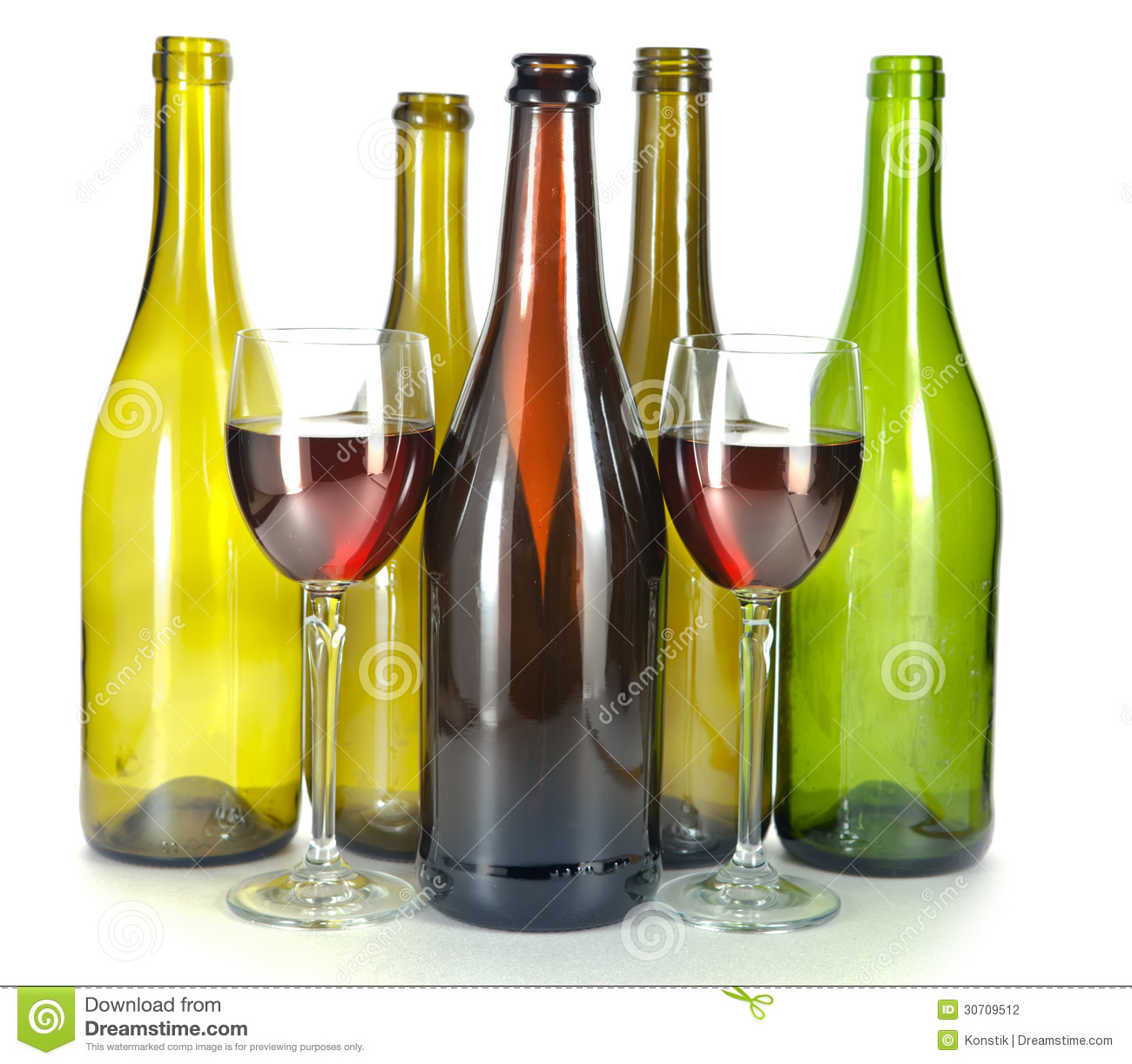 Empty glass bottles from under wine of various color and two glass stock photography image - Empty colored wine bottles ...