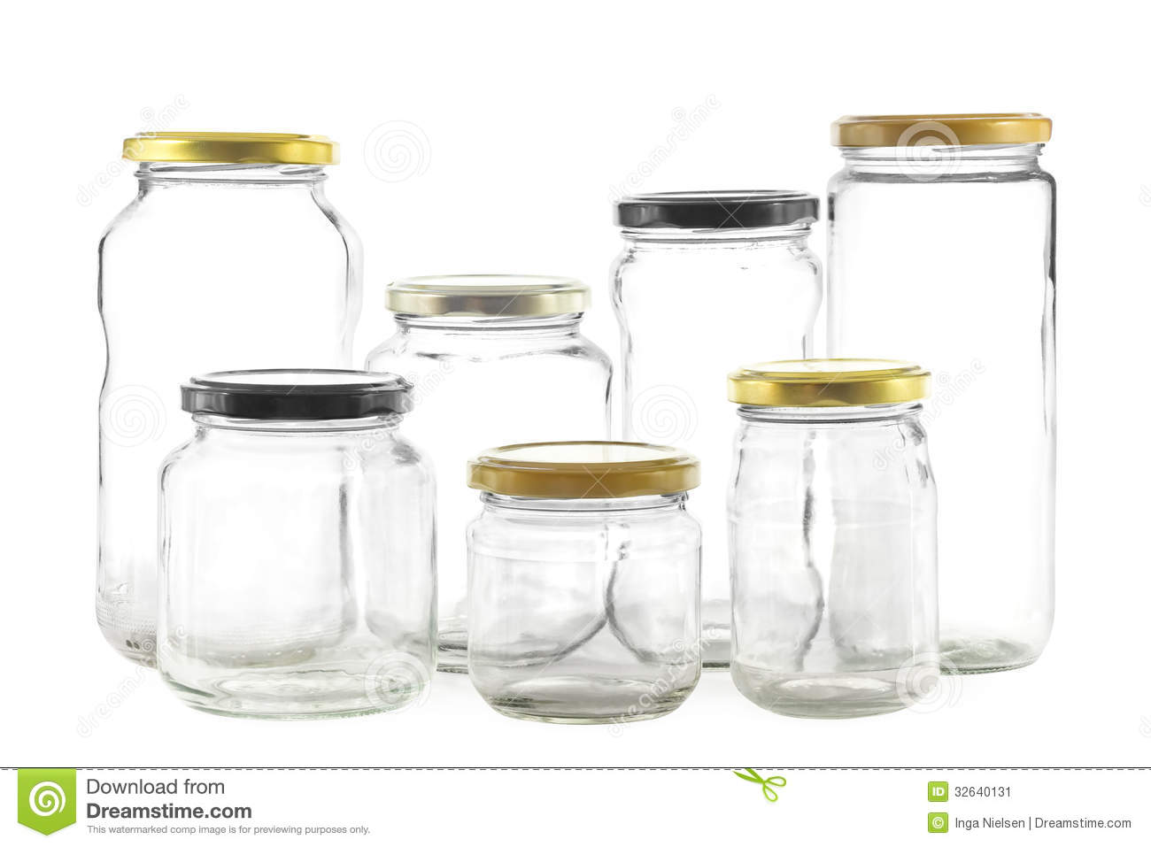 Group of seven different empty glass jars for preserves.