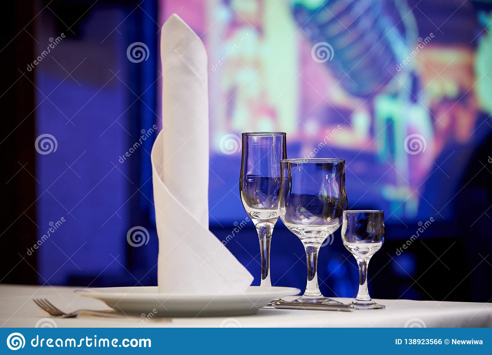 Empty glasses on the banquet table.Table setting for a banquet or dinner party