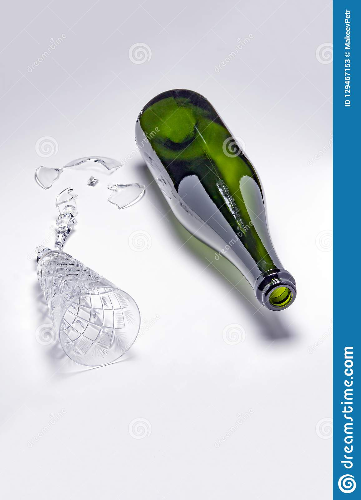Empty champagne bottle and broken wine glass