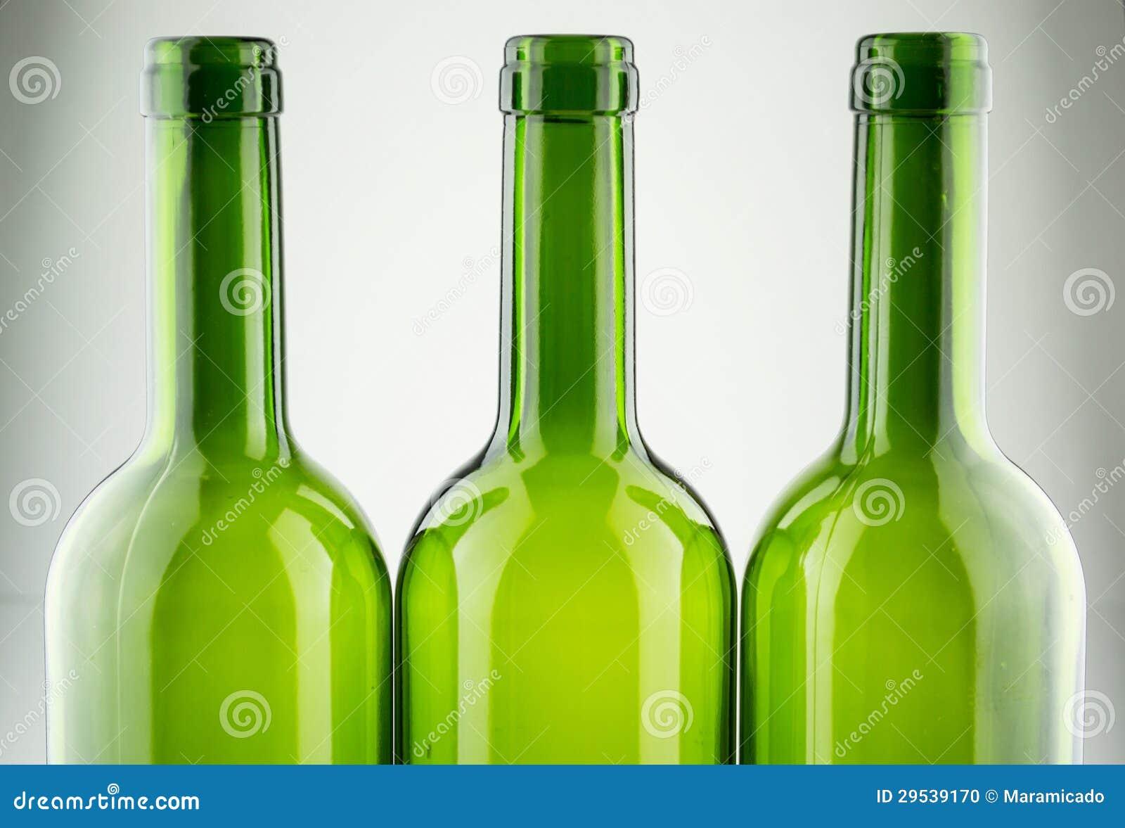 Empty green wine bottles isolated on white stock photo for Green wine bottles