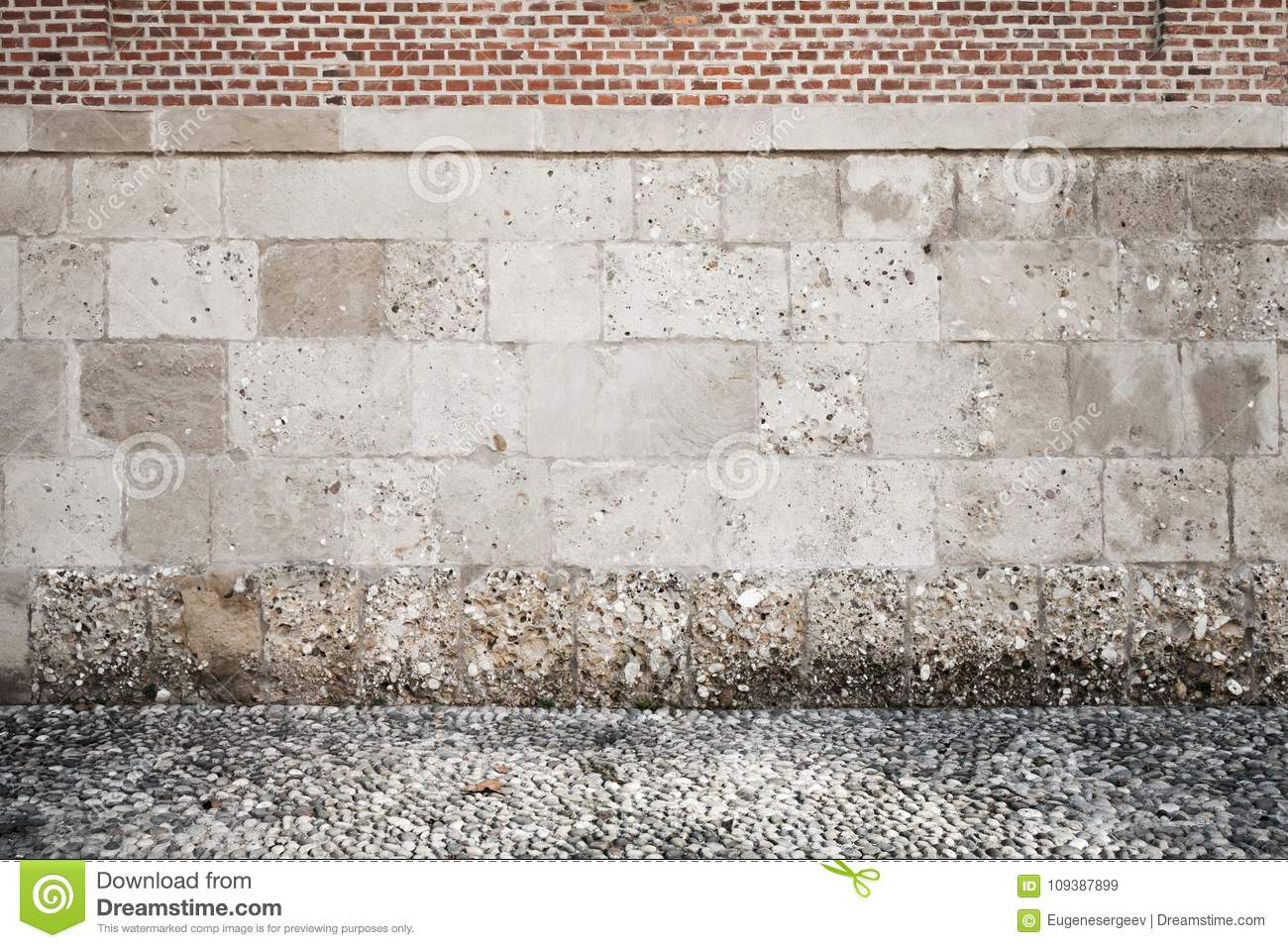 Empty Grunge Interior Background With Rough Wall Made Of Stone Blocks And  Red Bricks