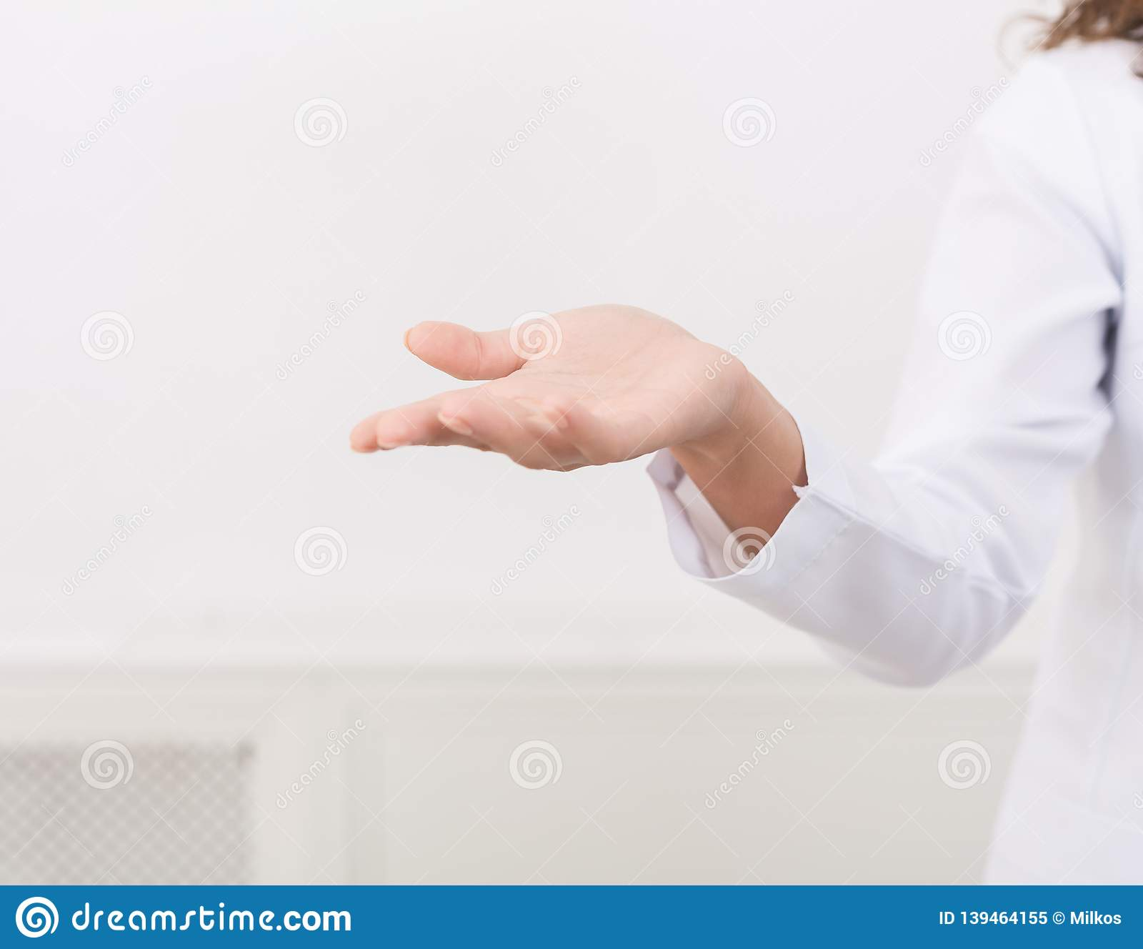 Empty hand of female doctor on white background