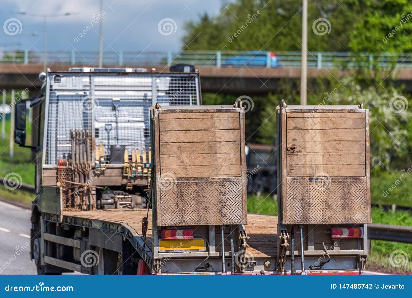 Empty haulage trailer truck on uk motorway in fast motion
