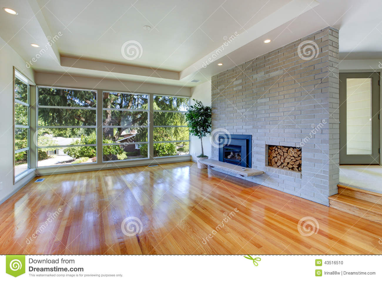Empty house interior. Living room with glass wall and brick wall