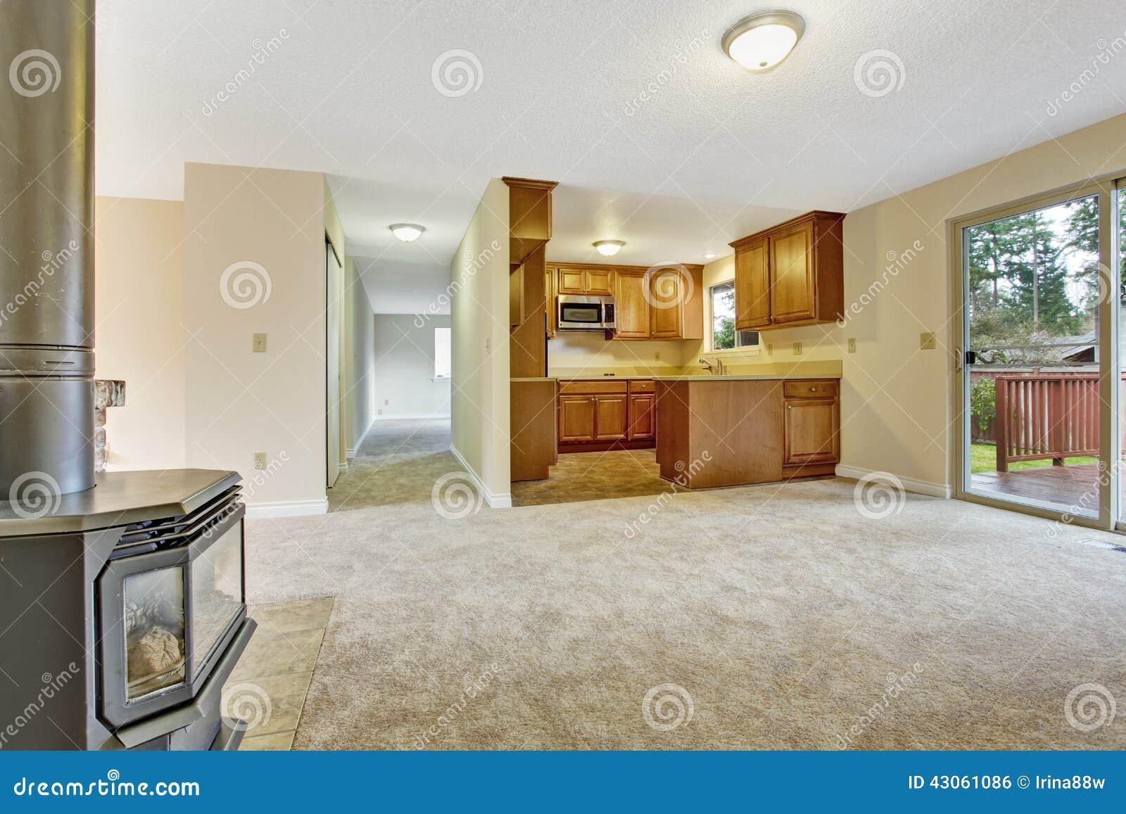 Empty house interior living room with kitchen area stock for Cocinar al vacio en casa