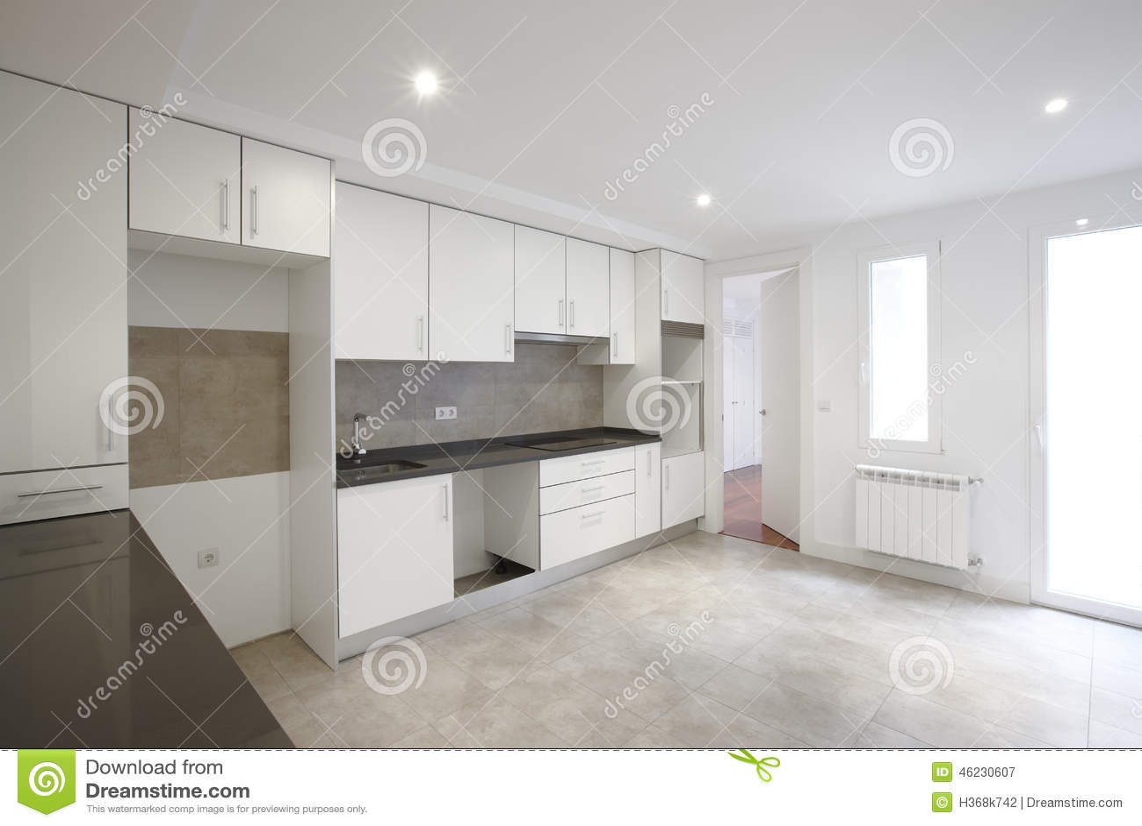 Empty House Kitchen With White Furniture Stock Photo