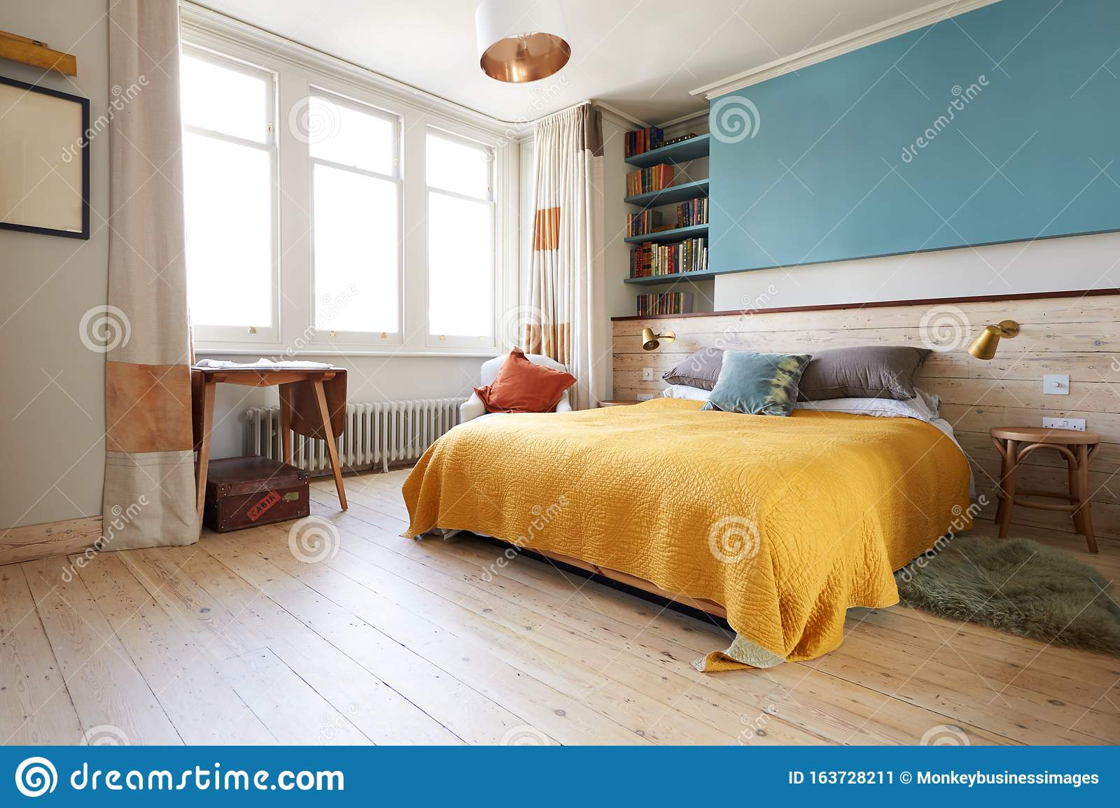 empty interior of contemporary bedroom with desk and
