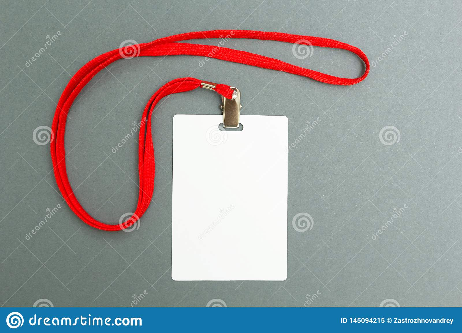 Empty layout layout isolated on black. A common blank label name tag hanging on the neck with a red thread on a gray background