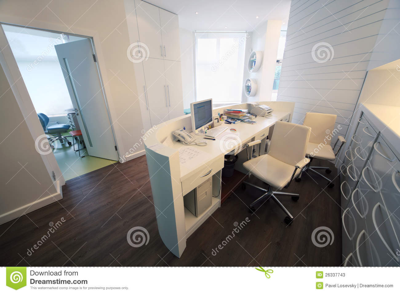 Empty Lit Reception Area In Dental Clinic Stock Image