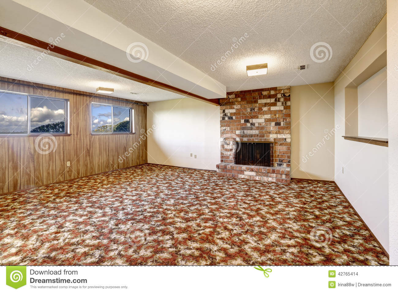 Empty Living Room With Brick Fireplace And Colorful Carpet Floor Stock Photo - Image: 42765414