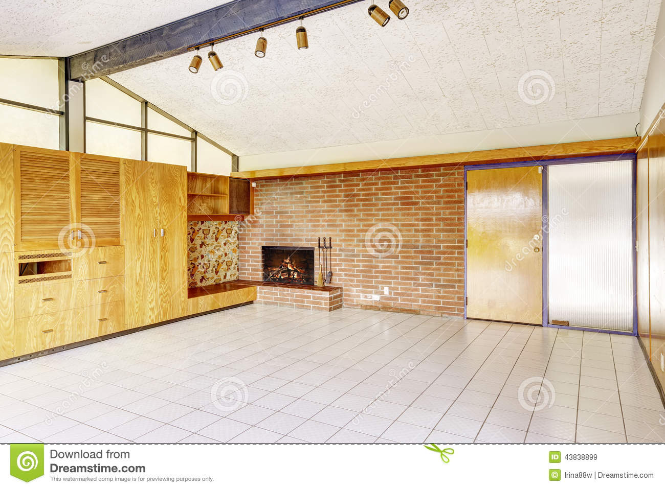 Empty living room with brick wall trim and fireplace stock image empty living room with brick wall trim and fireplace dailygadgetfo Gallery