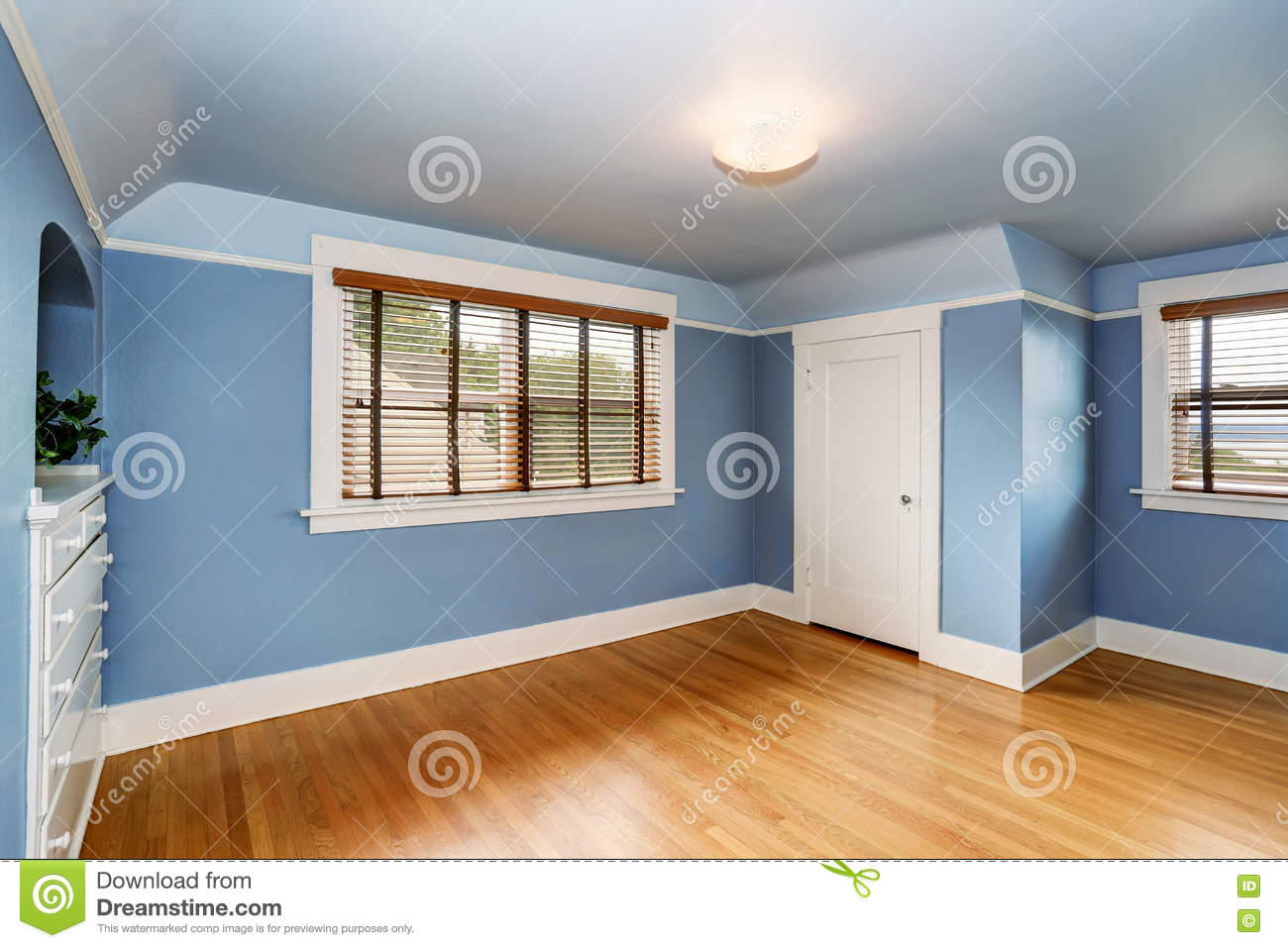 Empty Living Room Interior With Blue Walls And Hardwood Floor
