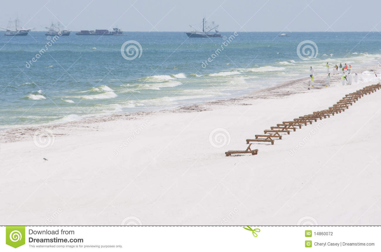 Empty lounge chairs on oil-soaked beach