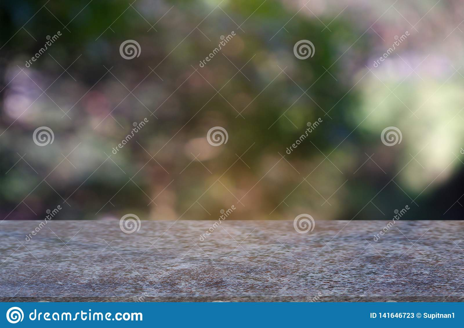 Empty marblestone table in front of abstract blurred green of garden and nature light background. For montage product display or