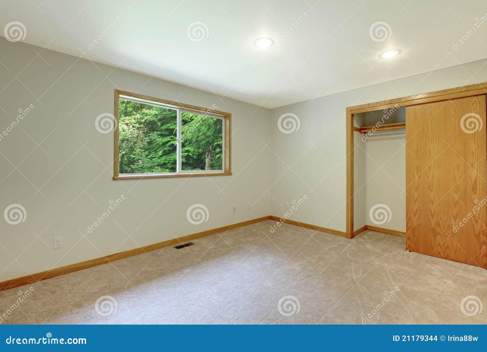 Empty new white room with open closet door.