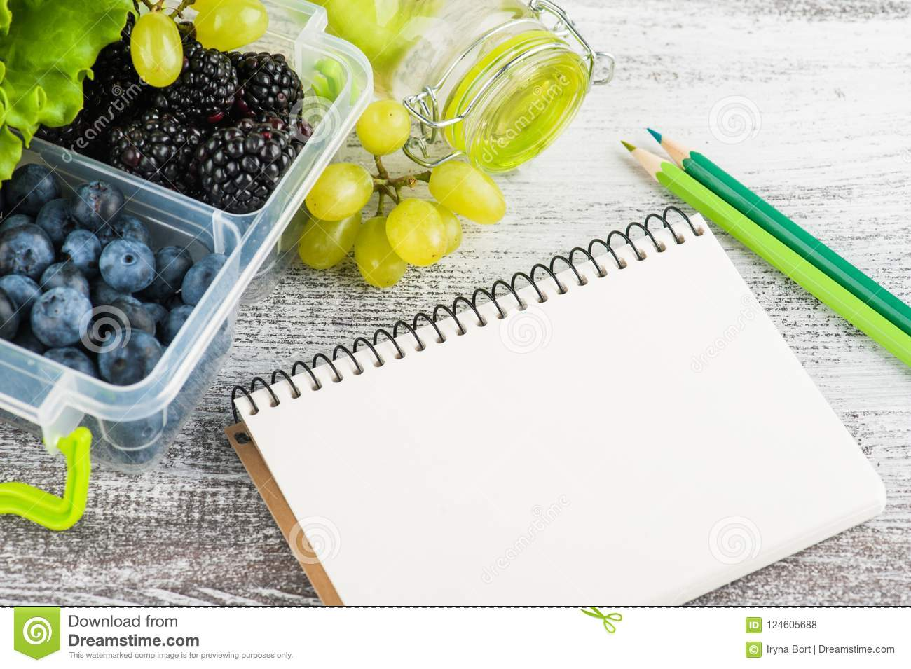 Empty notebook and berries