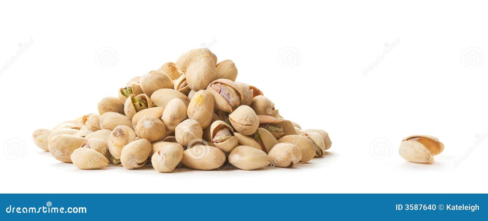 Empty Nutshell beside Pistachios