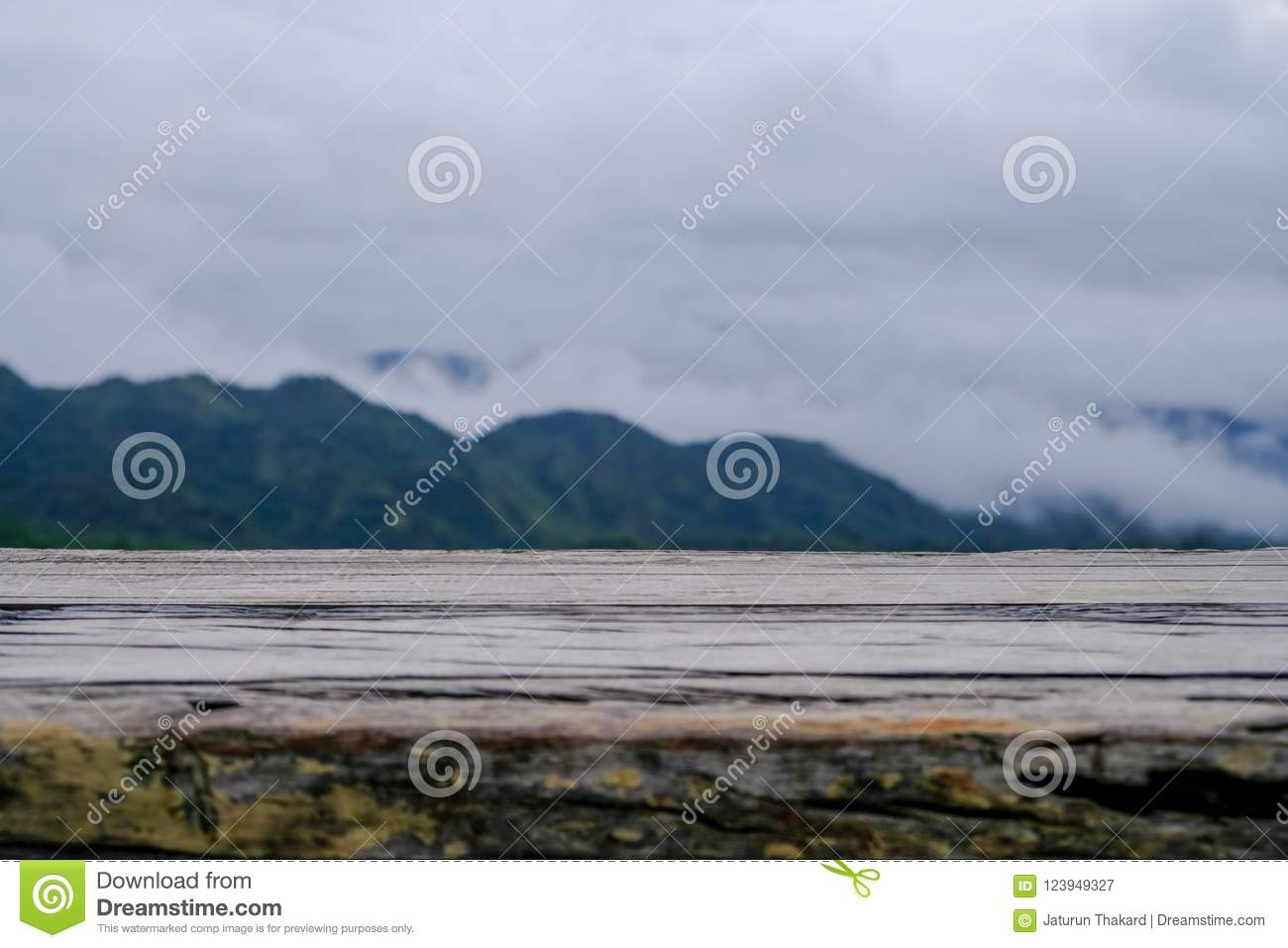 Old Wood Table Texture On Mountain And Mostly Cloudy Background
