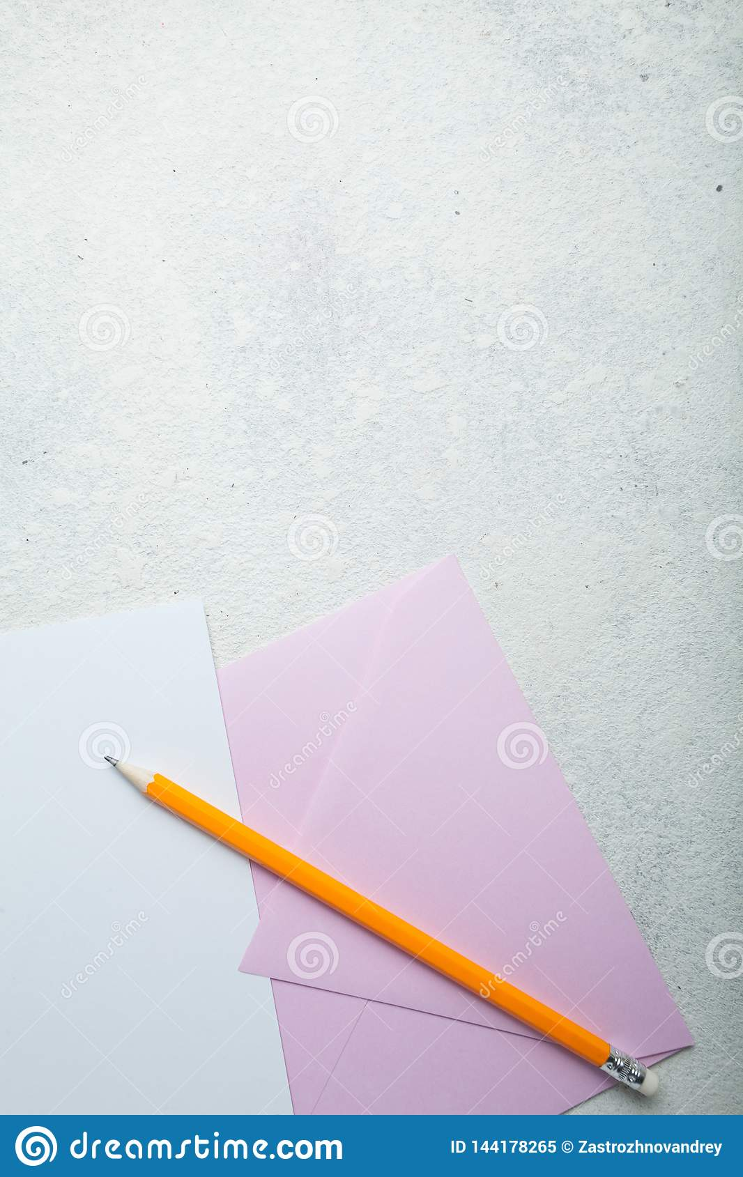 Empty open romantic letter with a pink envelope on a white background