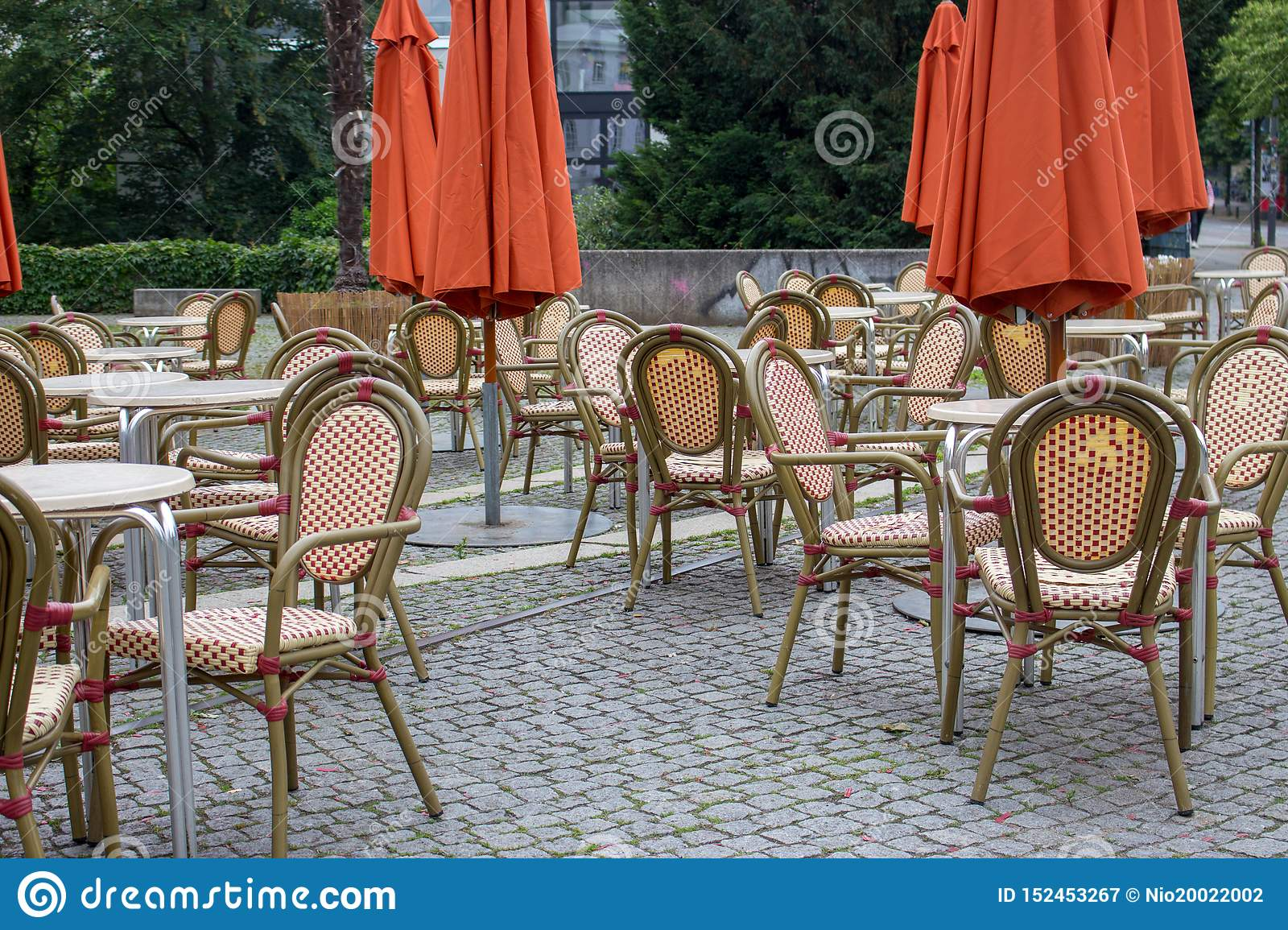 Fabulous Empty Outdoor Cafe With Closed Umbrellas Street Cafe With Short Links Chair Design For Home Short Linksinfo