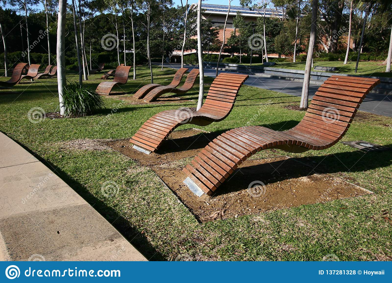 Awe Inspiring Empty Outdoor Wood Slat Chaise Lounge Chairs Hovering Above Ibusinesslaw Wood Chair Design Ideas Ibusinesslaworg