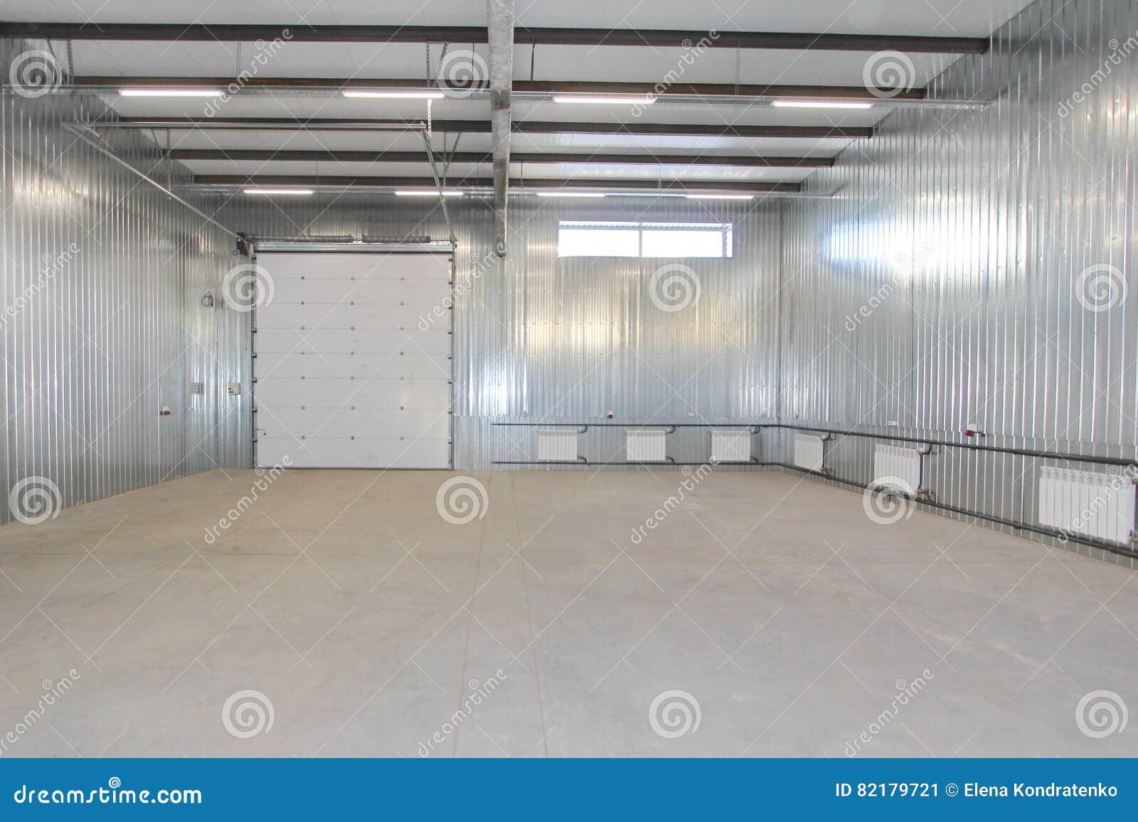 Interior windows - Empty Parking Garage Warehouse Interior With Large White Gates And Windows Inside Stock Photo