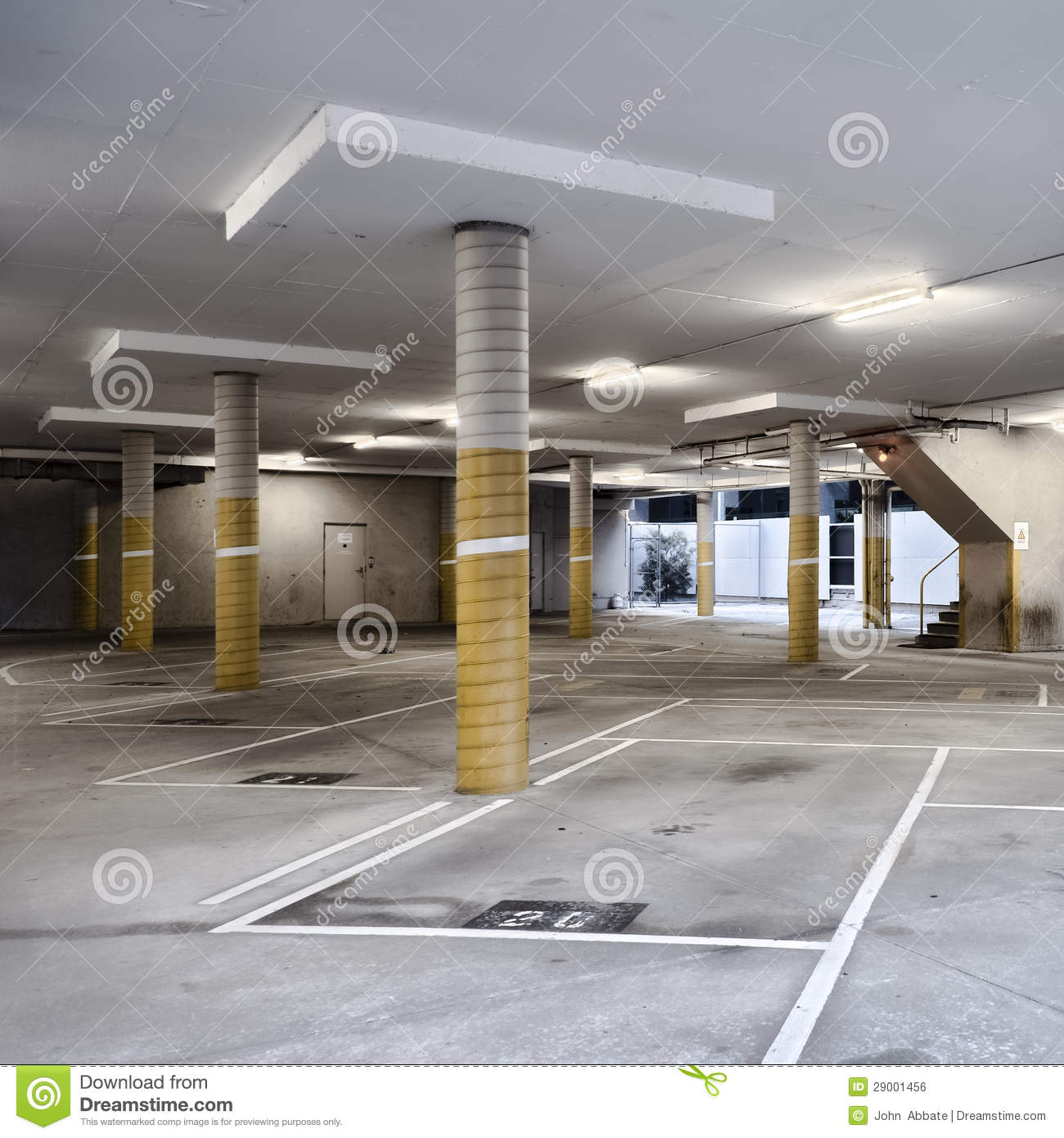Parking Garage Prices: Empty Parking Undercroft With Yellow Pylons Stock Photo
