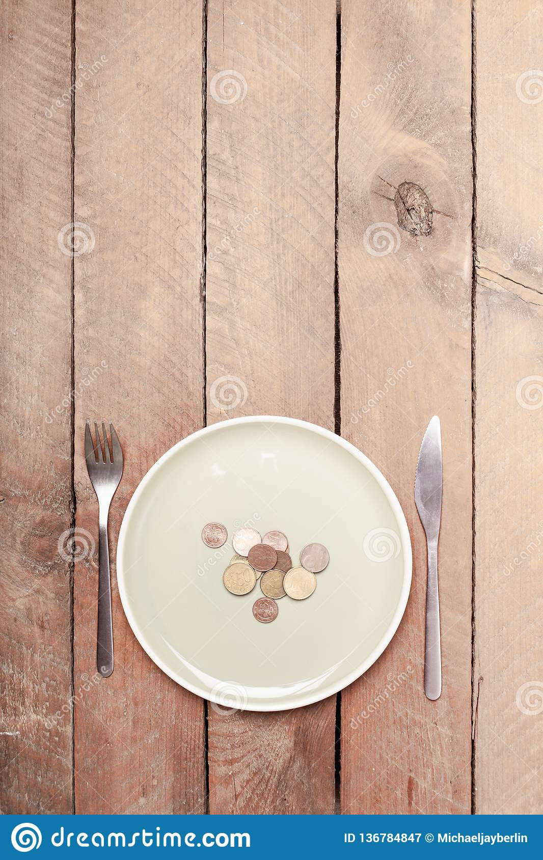 Empty pastel colored plate with coins