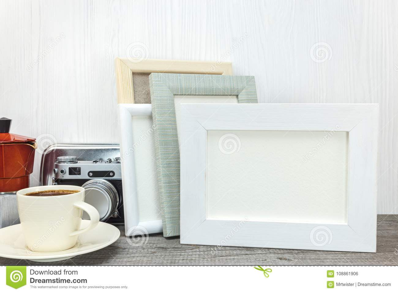 Empty Photo Frames With Cup Of Coffee On Wooden Desk Stock Photo ...
