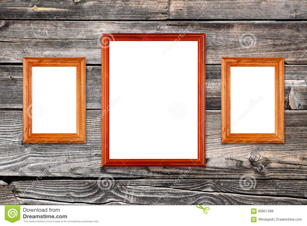 Empty photo frames on wooden wall