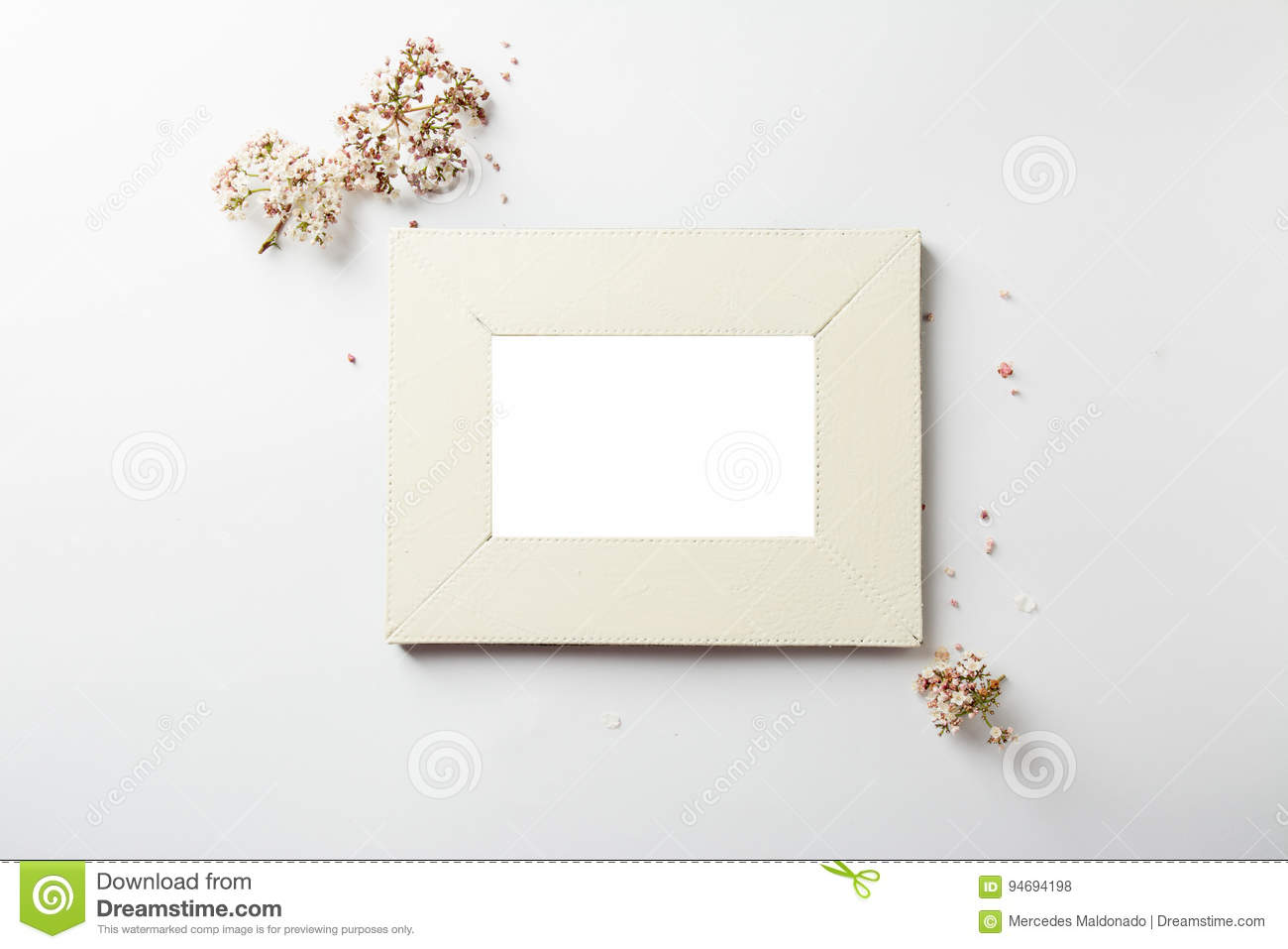 Empty Picture Frame Decorated With Small Pink Flowers Stock Photo