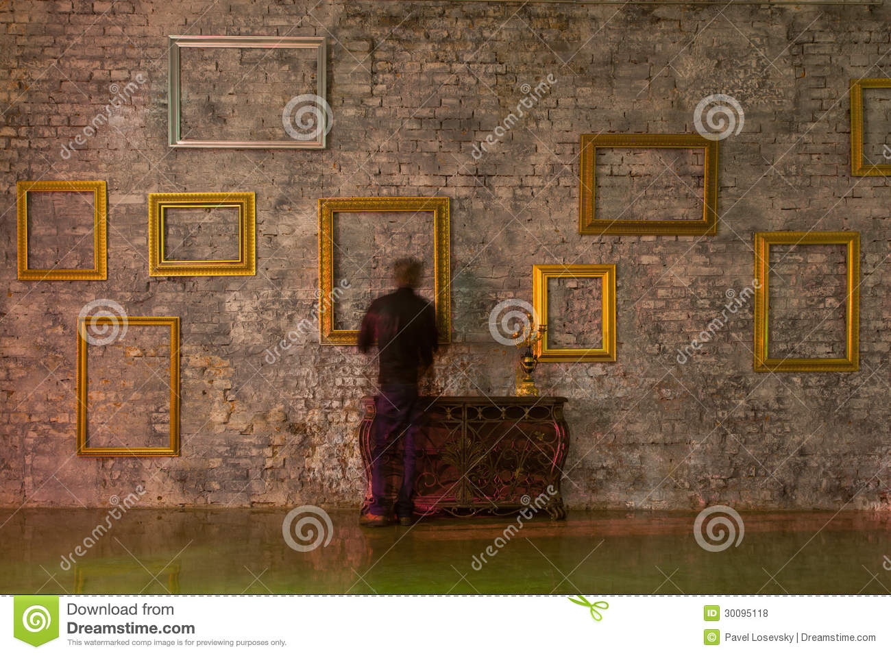Empty picture frames on the brick wall