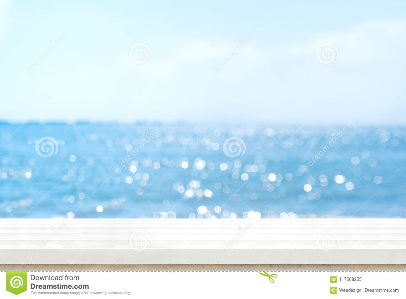 Empty plank white wood table top with blur blue sky and sea boekh background,summer holiday backdrop.Mock up template for display