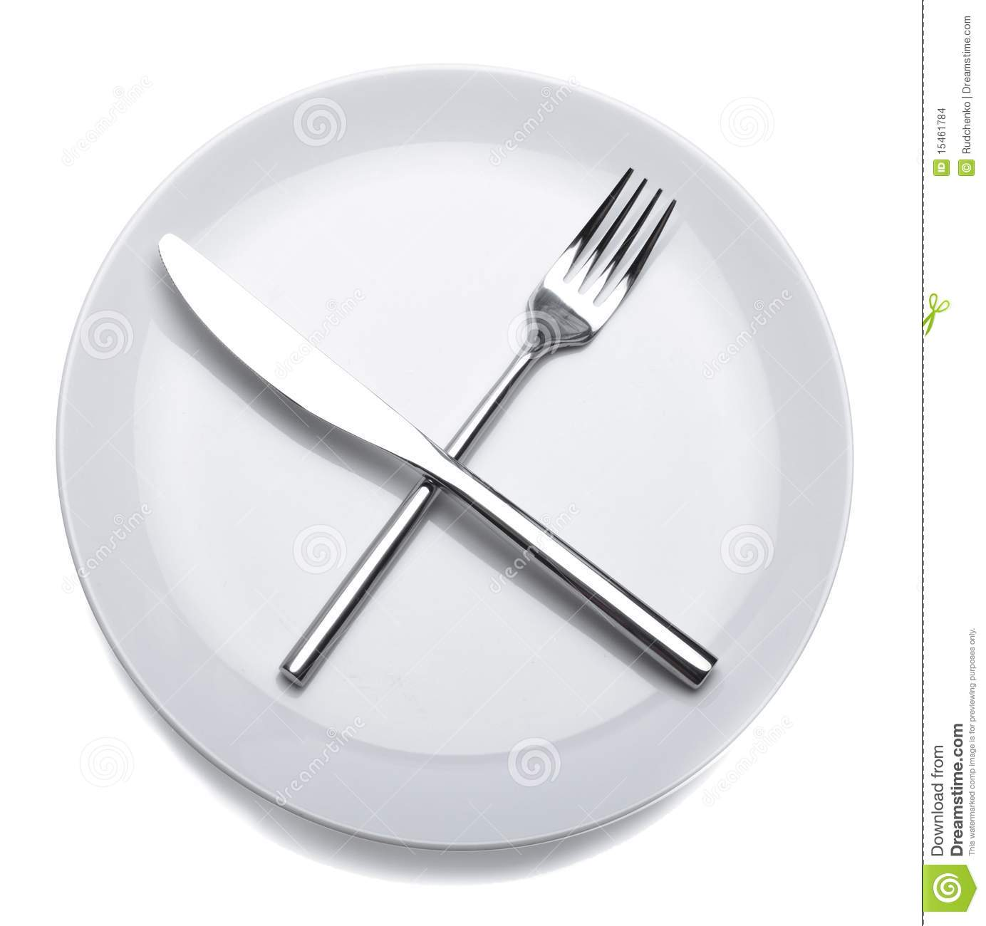 An empty white dish with knife and fork on a table - An Empty White Dish With Knife And Fork On A Table 48