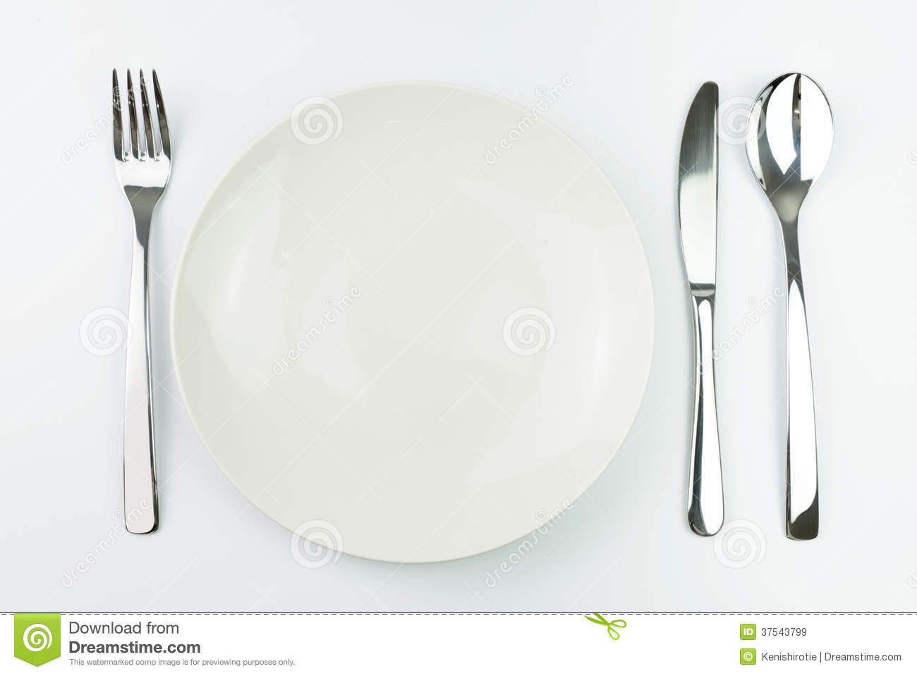 An empty white dish with knife and fork on a table - Dinner Empty Fork Knife