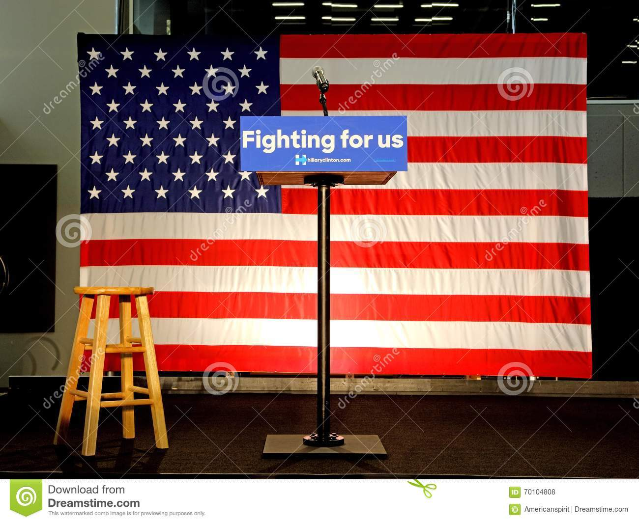 Empty Podium reads  Fighting For US  at Hillary Clinton Rally at