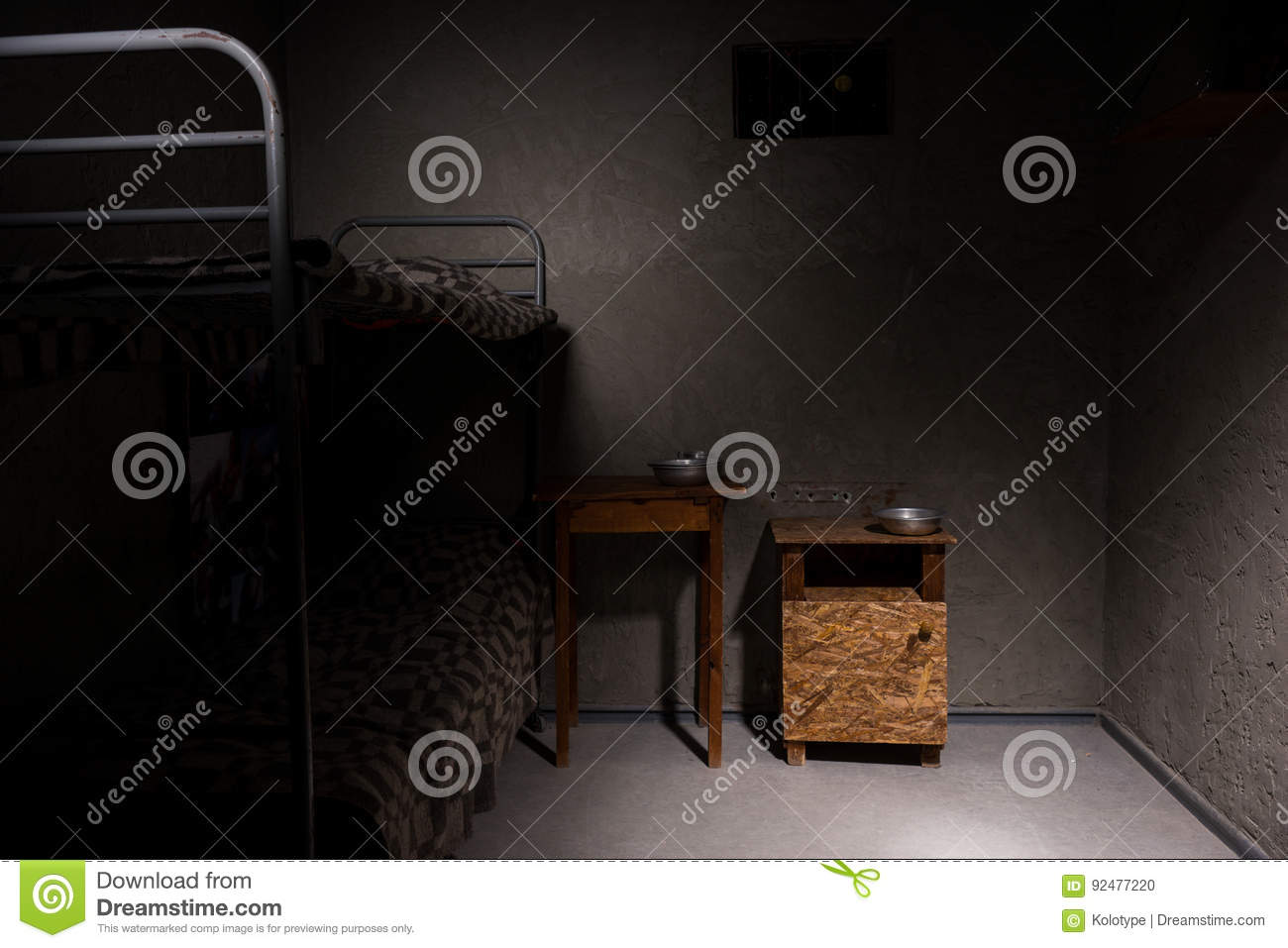 An Empty Prison Cell With Bunk Bed And Bedside Table Stock Photo