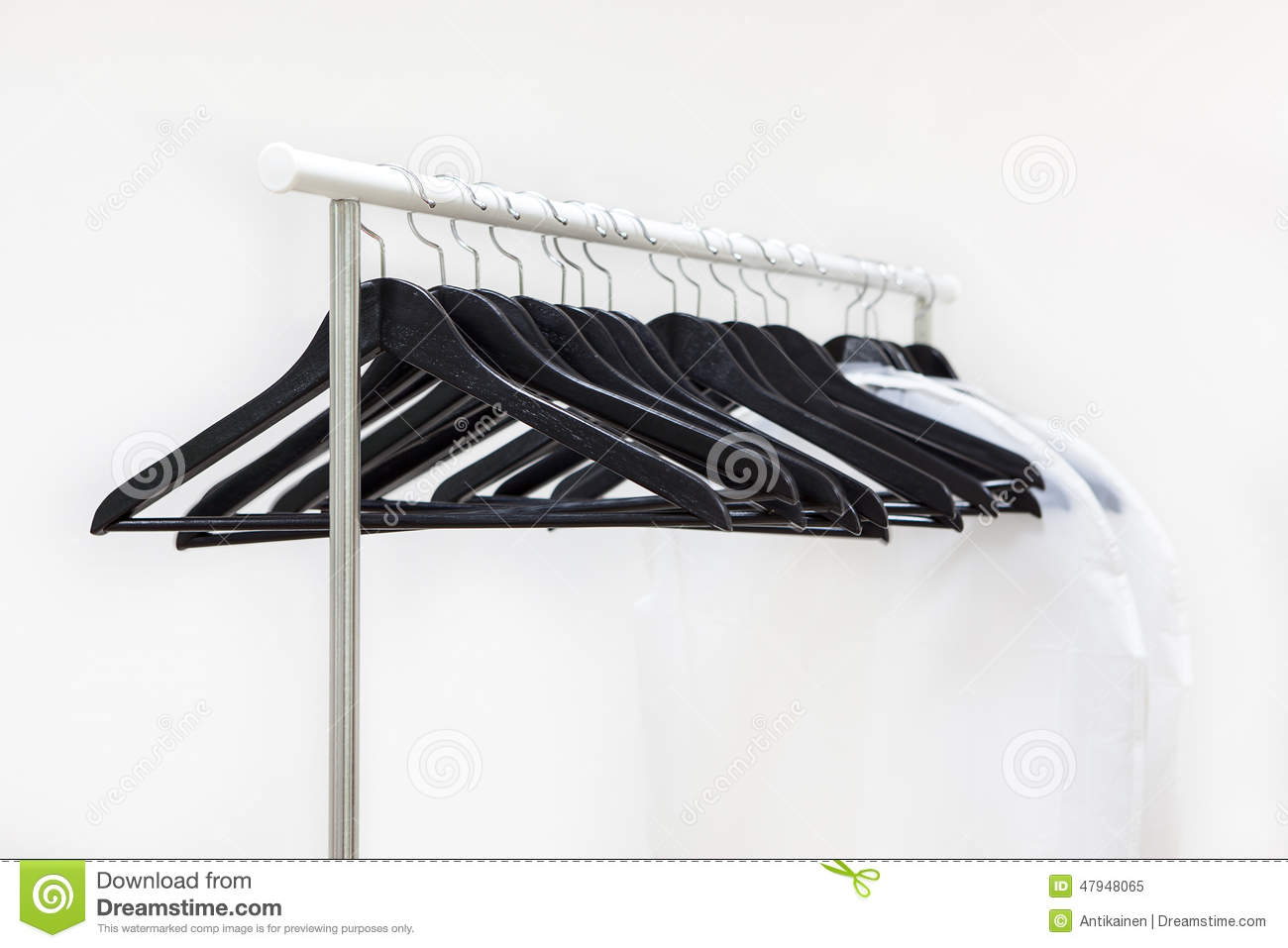 Empty Rack With Hanging Black Hangers And Bags For Clothes