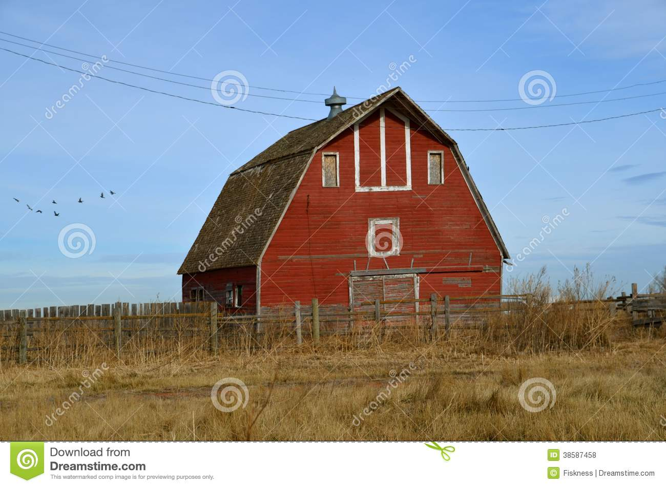 Empty red hip roof barn stock photo image of cupola for Hip roof barns