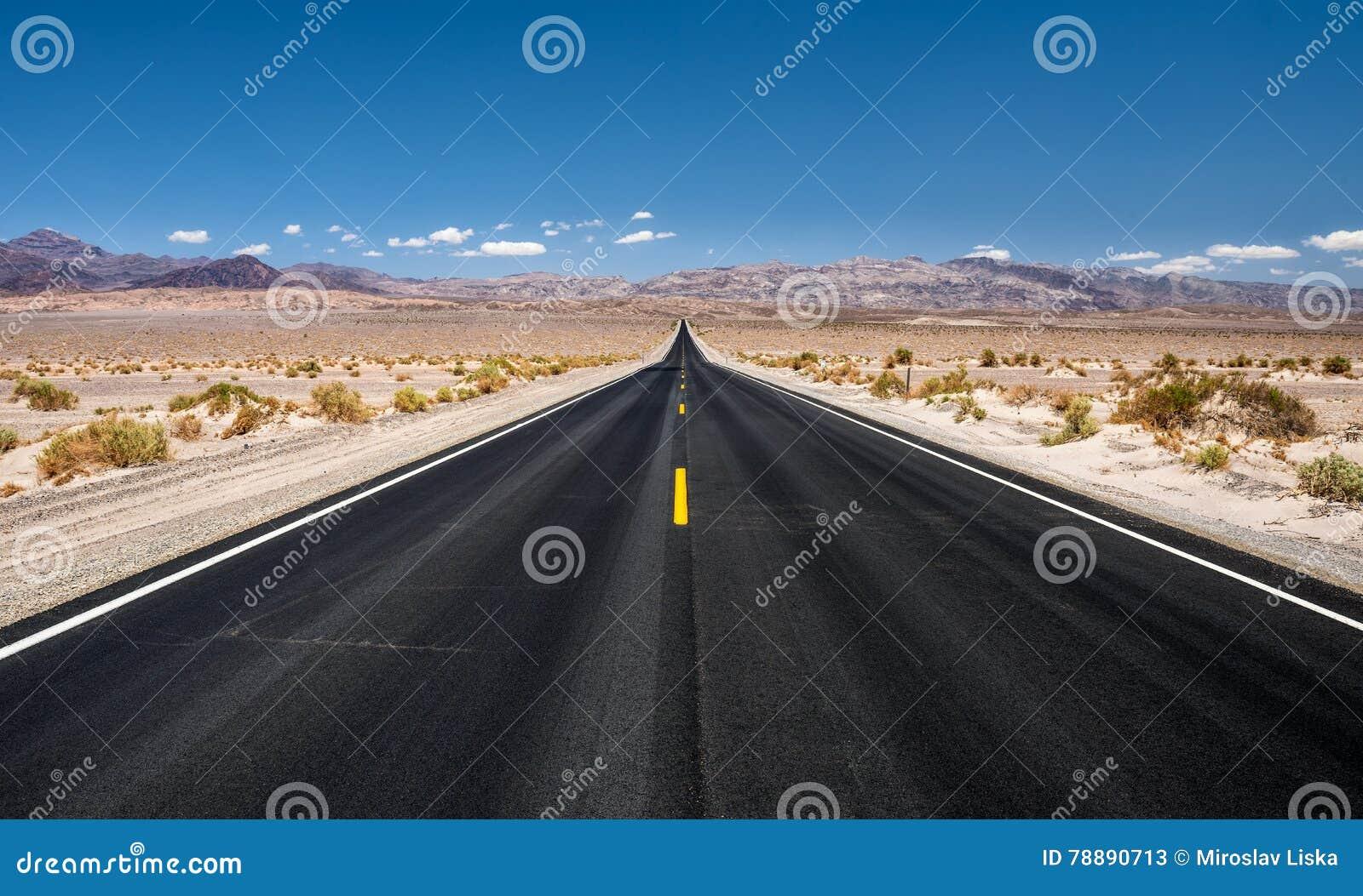 Empty road running through Death Valley National Park