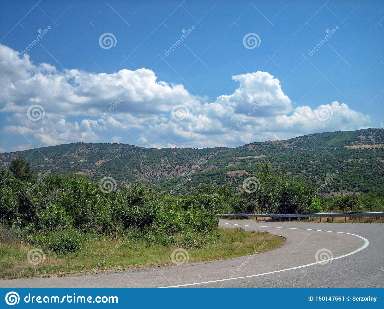 Empty road in the southern hilly-mountainous area on a hot summer day