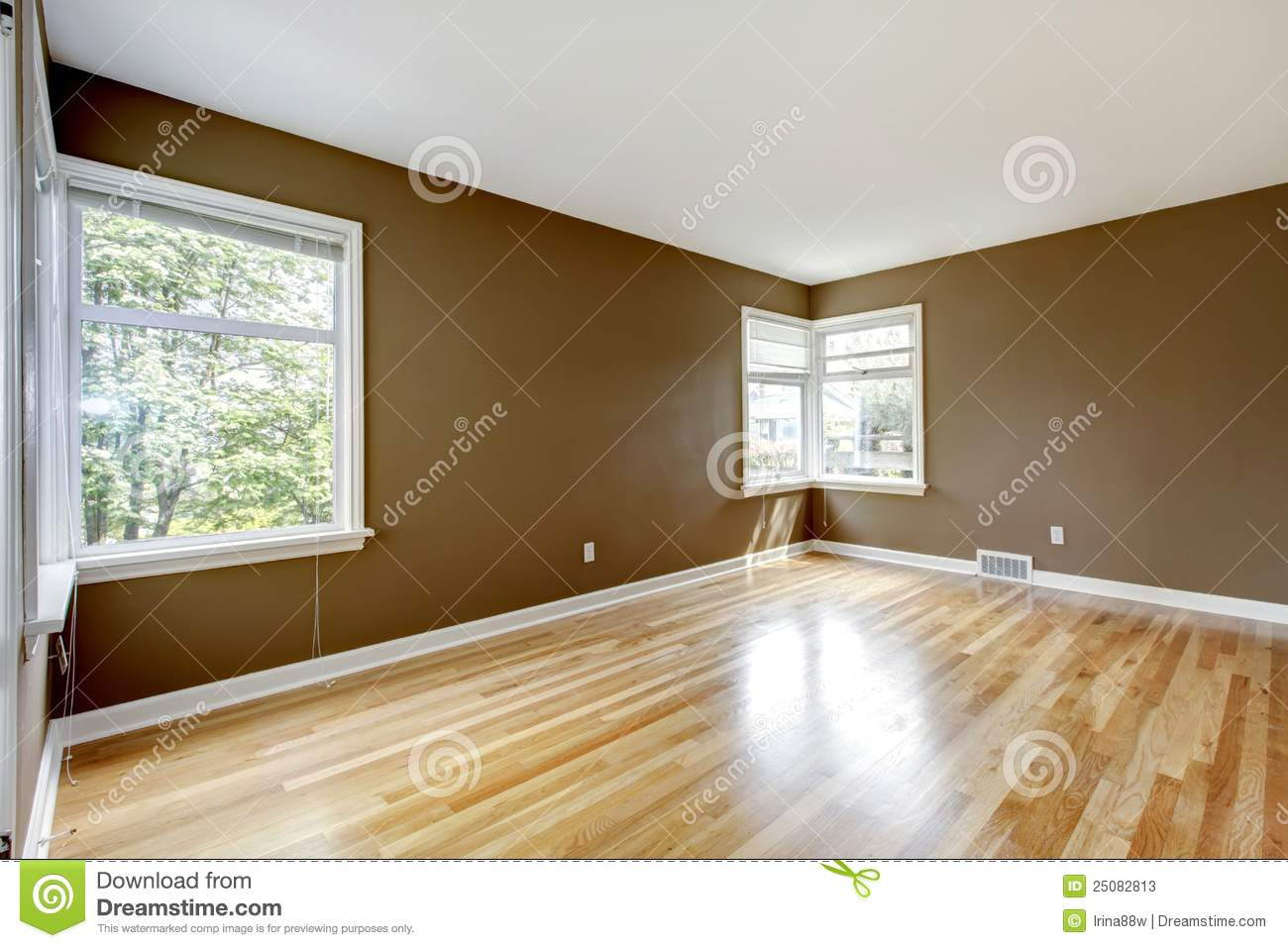 Empty Room With Brown Walls And Hardwood Floor Stock