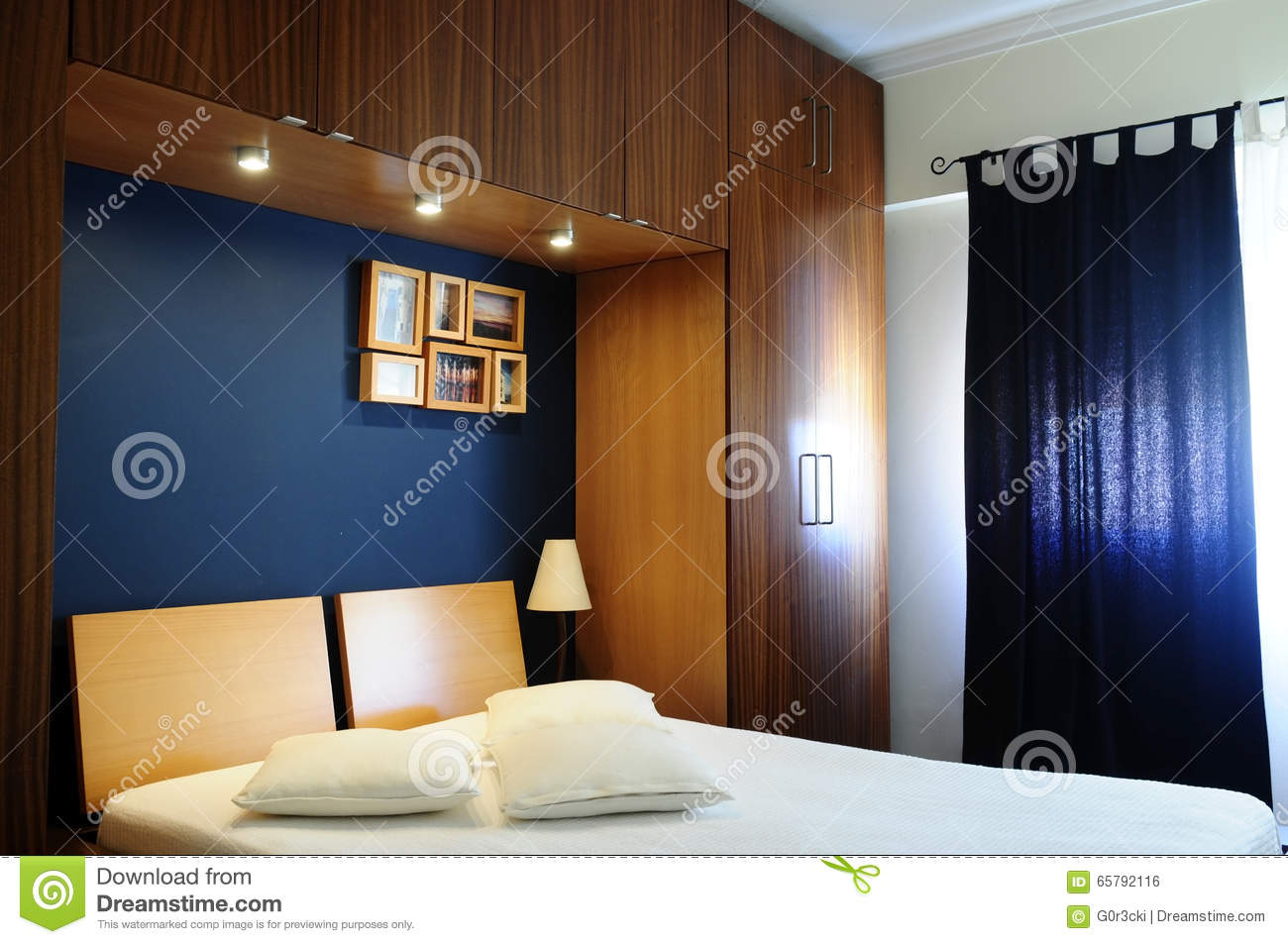 Empty Bed Room With Dark Navy Blue Wall And Wooden