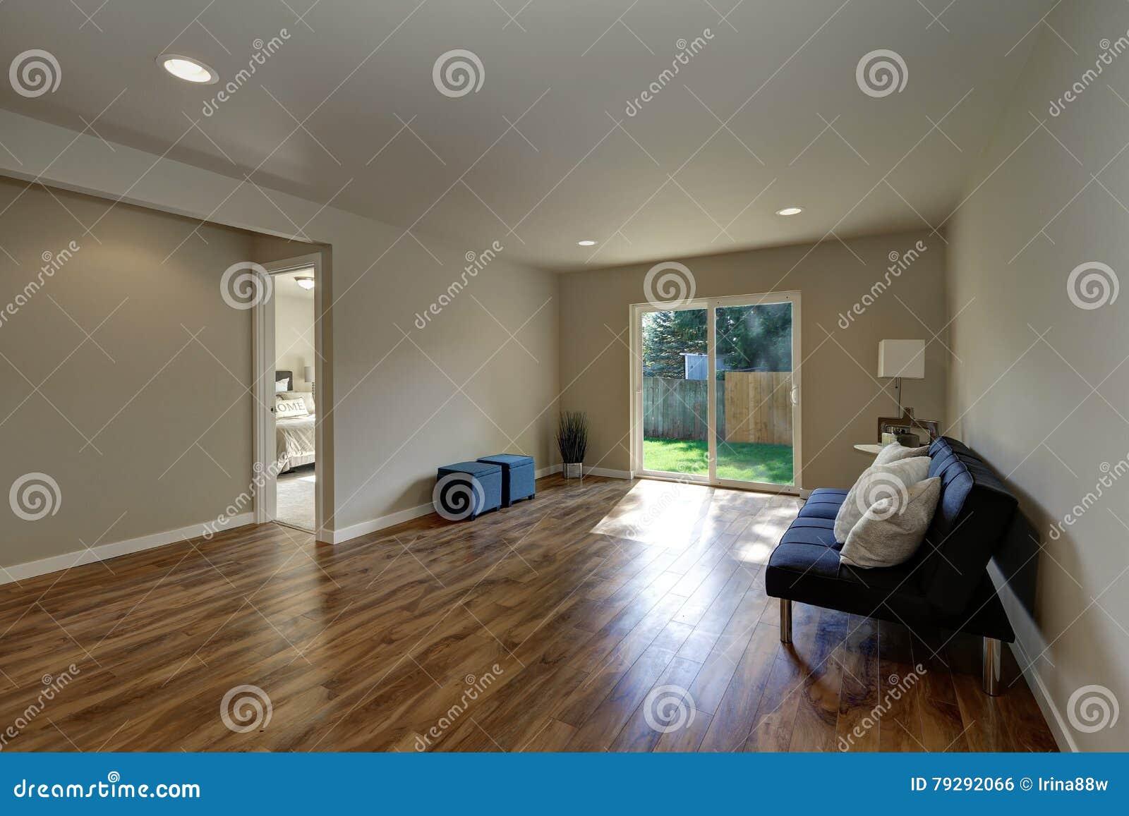 Empty Room Downstairs With Hardwood Floor And Glass Door Stock Photo
