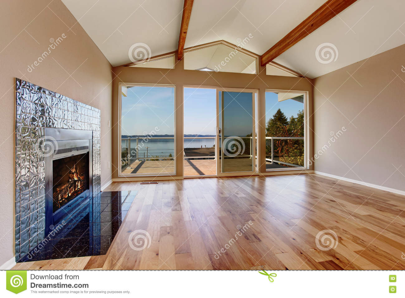 Empty Room Interior With Hardwood Floor Vaulted Ceiling And