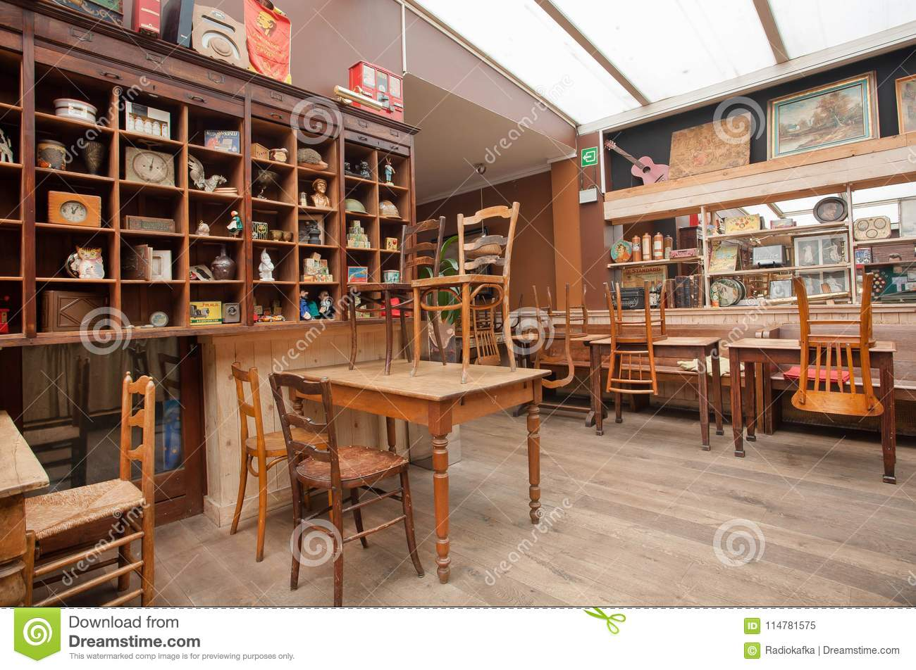 Empty Room In Vintage Style Cafe With Wooden Tables And