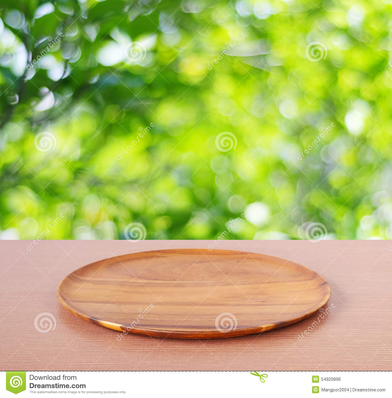 Empty Round Wooden Tray On Table Over Blur Tree Background