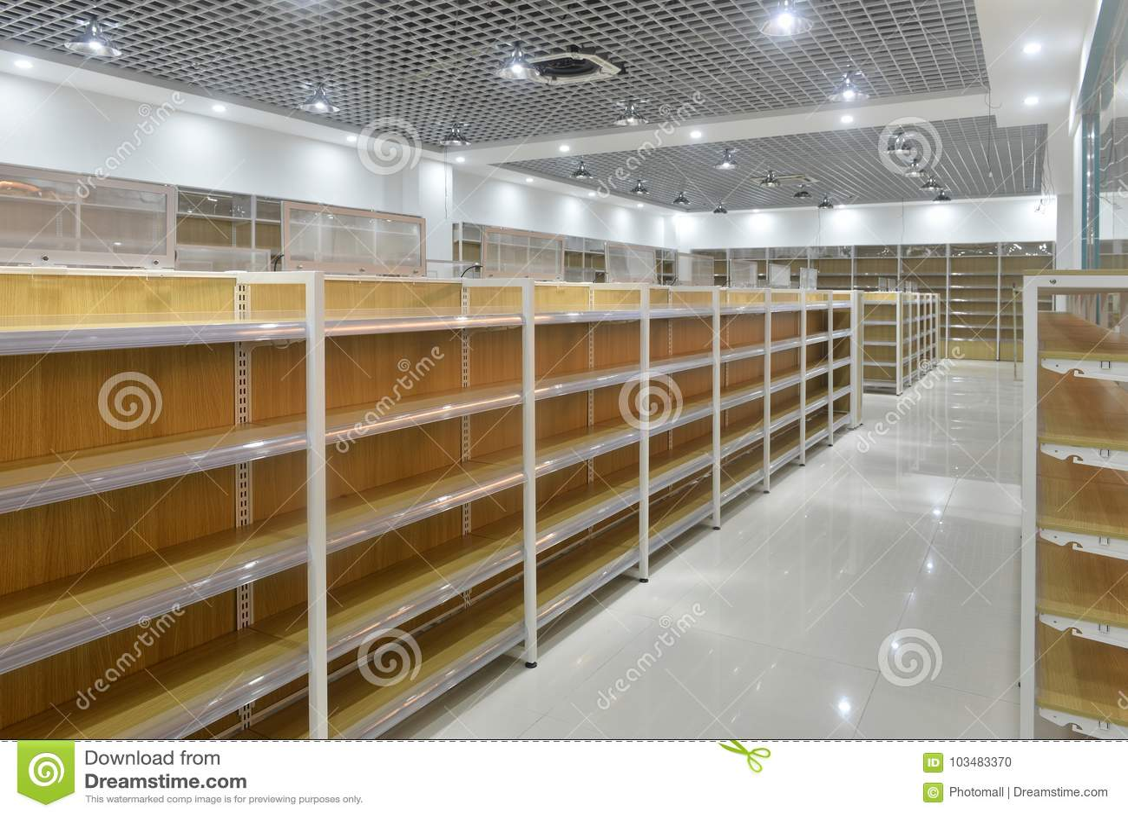 Empty shelves of supermarket interior
