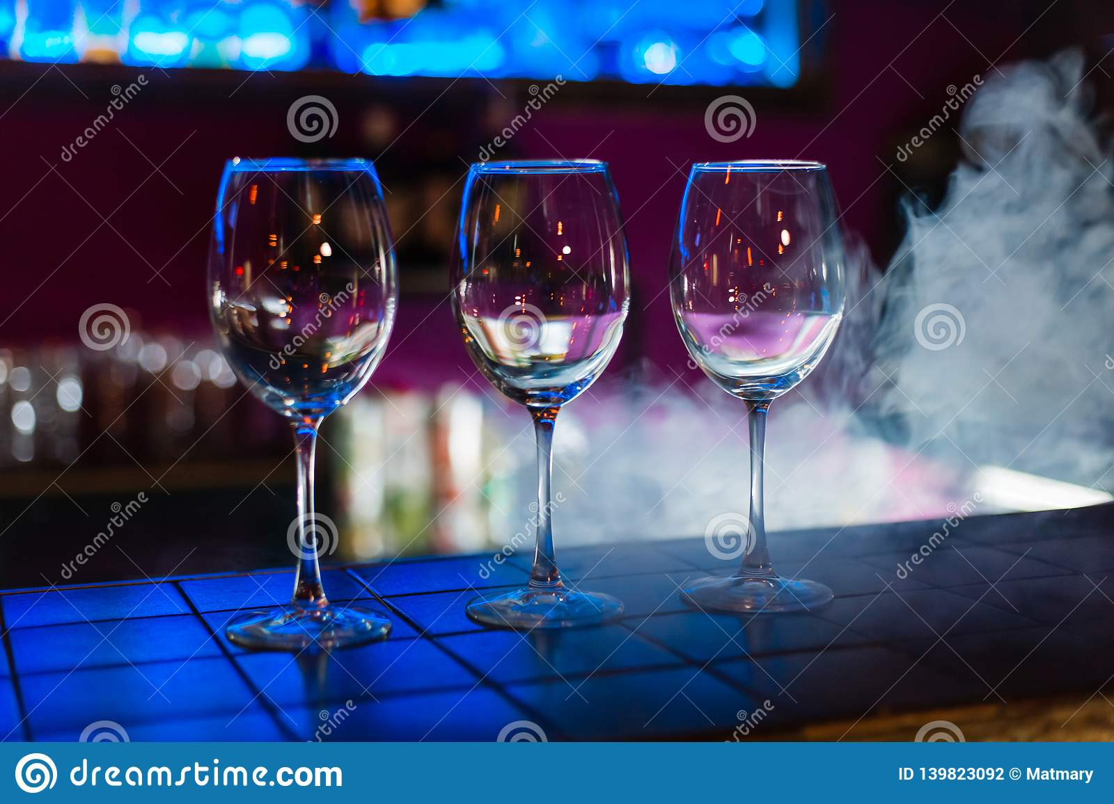 Empty wine glasses in row on bar or restaurant